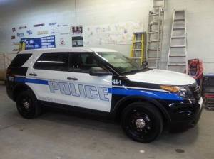 Waiting to hit the roads, one of two new police cars receives the final touches before it's put to work. (Photo courtesy of Huron TWP Police Department)