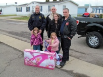 Young Huron residents Abigail and Azalea were all smiles when their new bikes arrived.