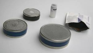 A typical charcoal radon test kit. Photo source: Google images.