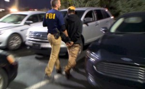 In Detroit, an FBI agent takes a suspected pimp into custody. Photo/FBI.gov.