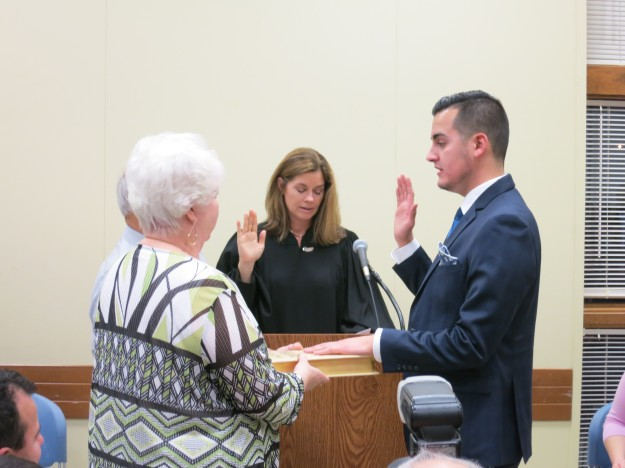 State Rep. Darrin Camilleri (D-Brownstown Township), right, takes the oath of office from Michigan Supreme Court Justice Bridget Mary McCormack on Tuesday, Dec. 27, 2016, at the Brownstown Community Center in Brownstown Township. Patricia Quiroz, Camilleri's grandmother, holds the Quiroz family Bible. Photo courtesy of Michigan House Democrats.